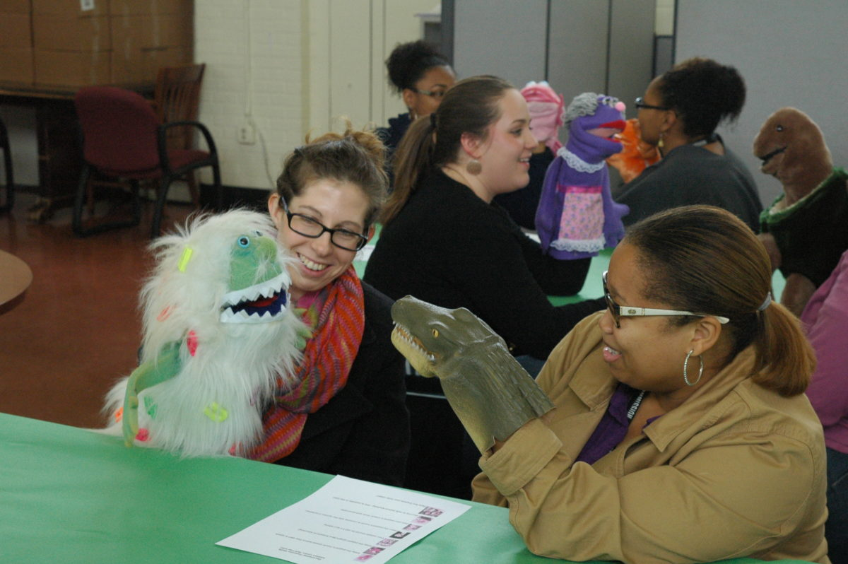 Teachers practicing with puppets