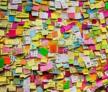 uplifting notes written on sticky notes