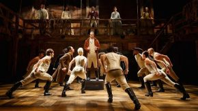 Hamilton cast performing on stage