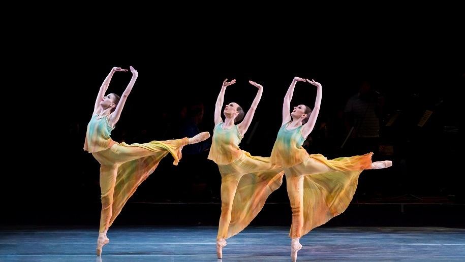 ballet dancers in yellow dresses