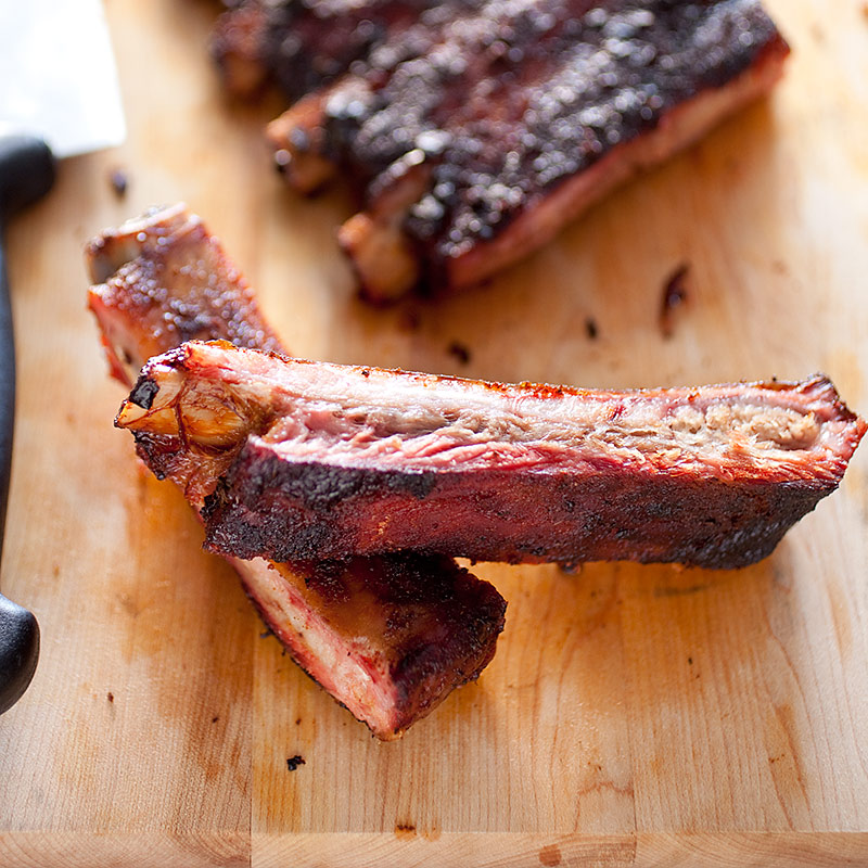Memphis Style Barbecued Spareribs On A Charcoal Grill