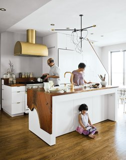 Secrets You Need to Know When Using Wood in Wet Spaces - Photo 6 of 11 - The Mandayam–Vohra family's Brooklyn kitchen is highlighted by a gold hood that complements Workstead's signature three-arm chandelier, shown here in its horizontal configuration.