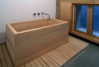 Secrets You Need to Know When Using Wood in Wet Spaces - Photo 9 of 11 - The bathtub is a simple box made of fragrant hinoki cypress. Its shape echoes one of Cho's favorite inspirations: a wooden apple crate.