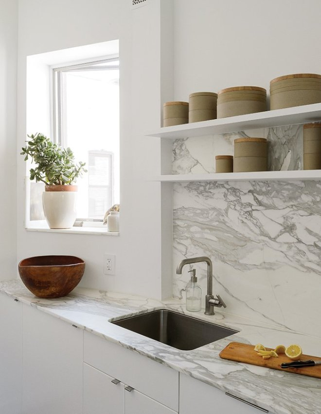 25 Backsplash Ideas For Your Kitchen Renovation - Photo 4 of 25 - The showstopping material elements are the Borghini honed marble countertop and backsplash by Ann Sacks. Hasami porcelain vessels line the open shelving.