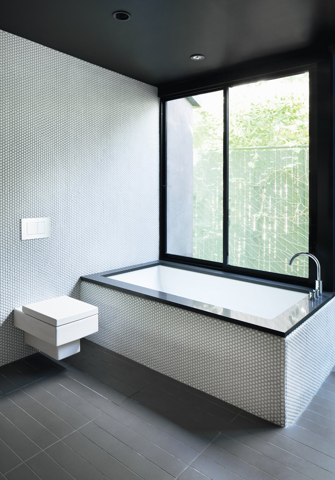 """Architect Noah Walker points out while referring to the bathroom he designed for a renovated Hollywood bungalow, """"I love minimal bathrooms with natural light—less is more. Make sure to pay attention to the details."""""""