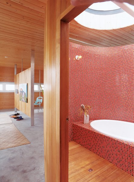 Fiery mosaics tile the majority of this Hawaiian tub room. Built and occupied by architect Craig Steely and his wife, the rest of the home is just as warm and tranquil aptly named Lavaflow 2.