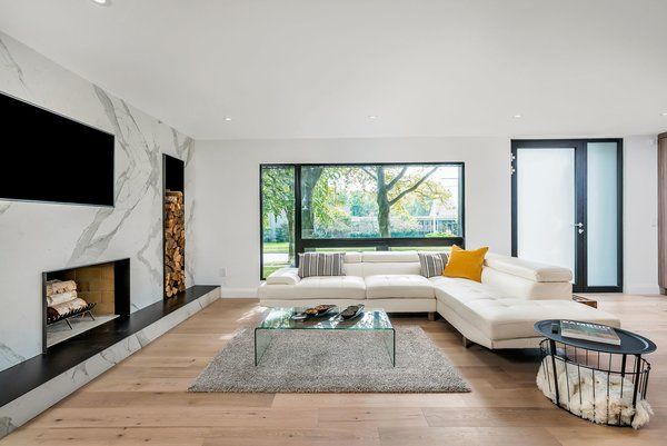 Modern home with Living Room, Wood Burning Fireplace, and Light Hardwood Floor. Photo 4 of Modern Renovation