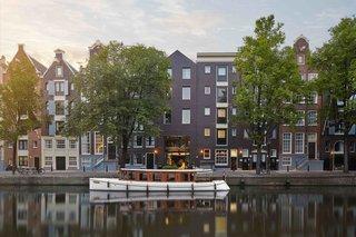 12 hôtels modernes dans les bâtiments historiques du monde entier - Photo 5 sur 24 - Situé dans les 25 maisons traditionnelles du canal des XVIIe et XVIIIe siècles à Amsterdam, le Pulitzer, récemment rénové, dispose d'une sélection de suites à thème unique.