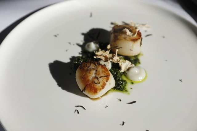 Truffle finds its way to dishes with scallop, artichokes and even desserts at Max's Restaurant.