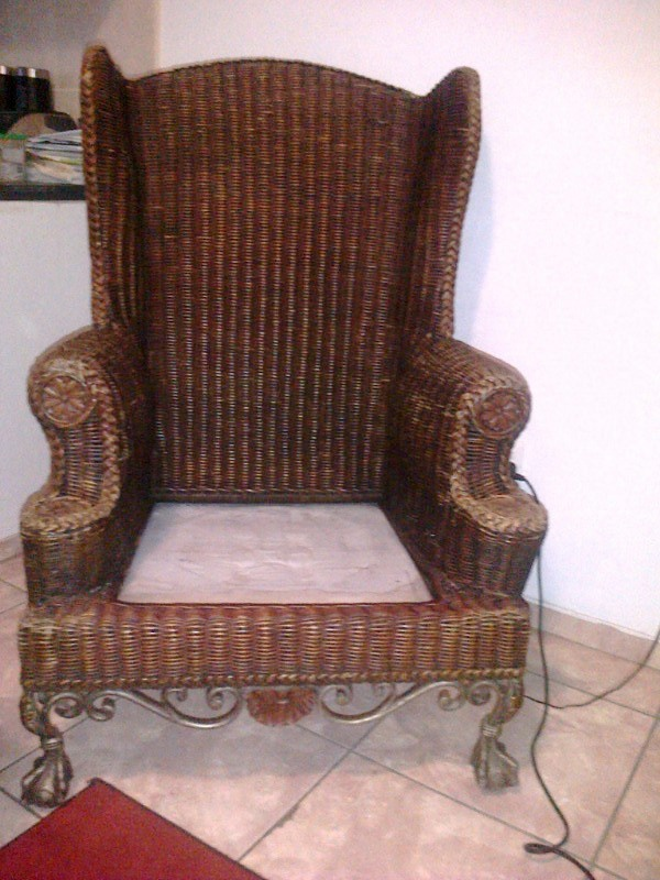 Beautiful Rattan Wicker Wingback chair with cast iron ball