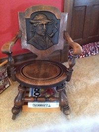 Wood rocking chair with man smoking a pipe | Collectors Weekly