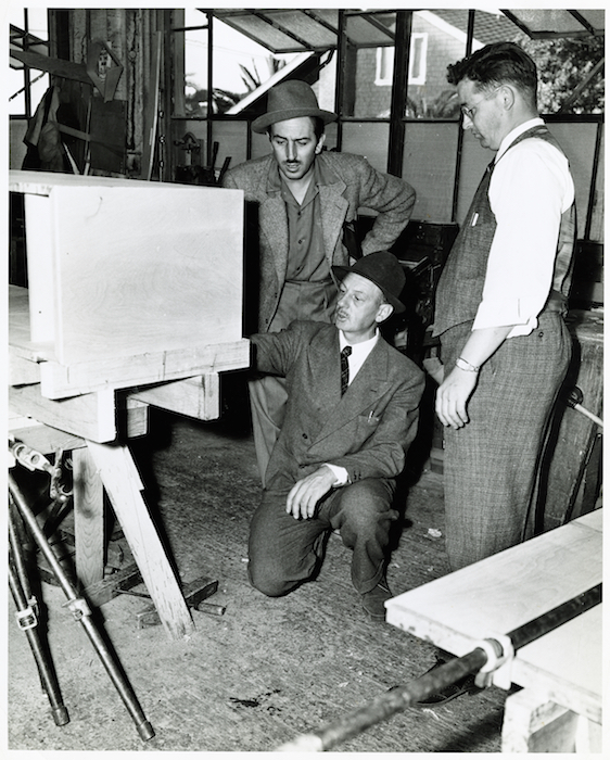 Kem Weber (kneeling), Walt Disney (in hat), and Howard Petersen in 1939. Peterson's company manufactured all of the Weber furniture for Disney's studio. Photo © UCSB.