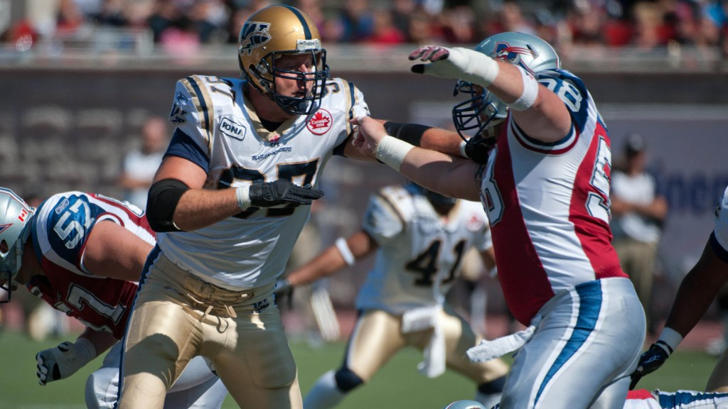 Winnipeg Blue Bombers defensive tackle Doug Brown (97) holds back Montreal Alouettes center Luc Brodeur-Jourdain, (58) during 1st half CFL action at Molson Stadium in Montreal Sunday, September 18, 2011. THE CANADIAN PRESS/Peter McCabe