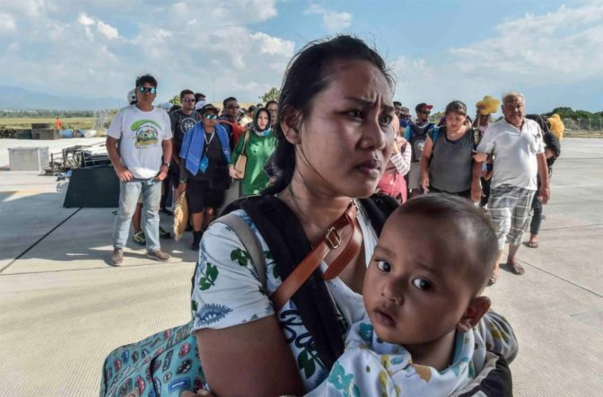 People injured or affected by the earthquake and tsunami wait to be evacuated on an air force plane in Palu, Indonesia, on Sept. 30. Photo by Antara Foto/Muhammad Adimaja via Reuters