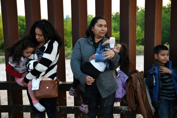 Central American migrants turn themselves in to U.S. Border Patrol as they seek asylum after illegally crossing the Rio Grande near Penitas, Texas, on April 6, 2019. Photo by Loren Elliott/Reuters
