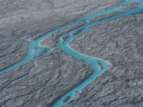 """A view of ice melting during a heatwave in Kangerlussuaq, Greenland is seen in this August 1, 2019 image obtained via social media. Photo by Caspar Haarloev from """"Into the Ice"""" documentary via Reuters"""