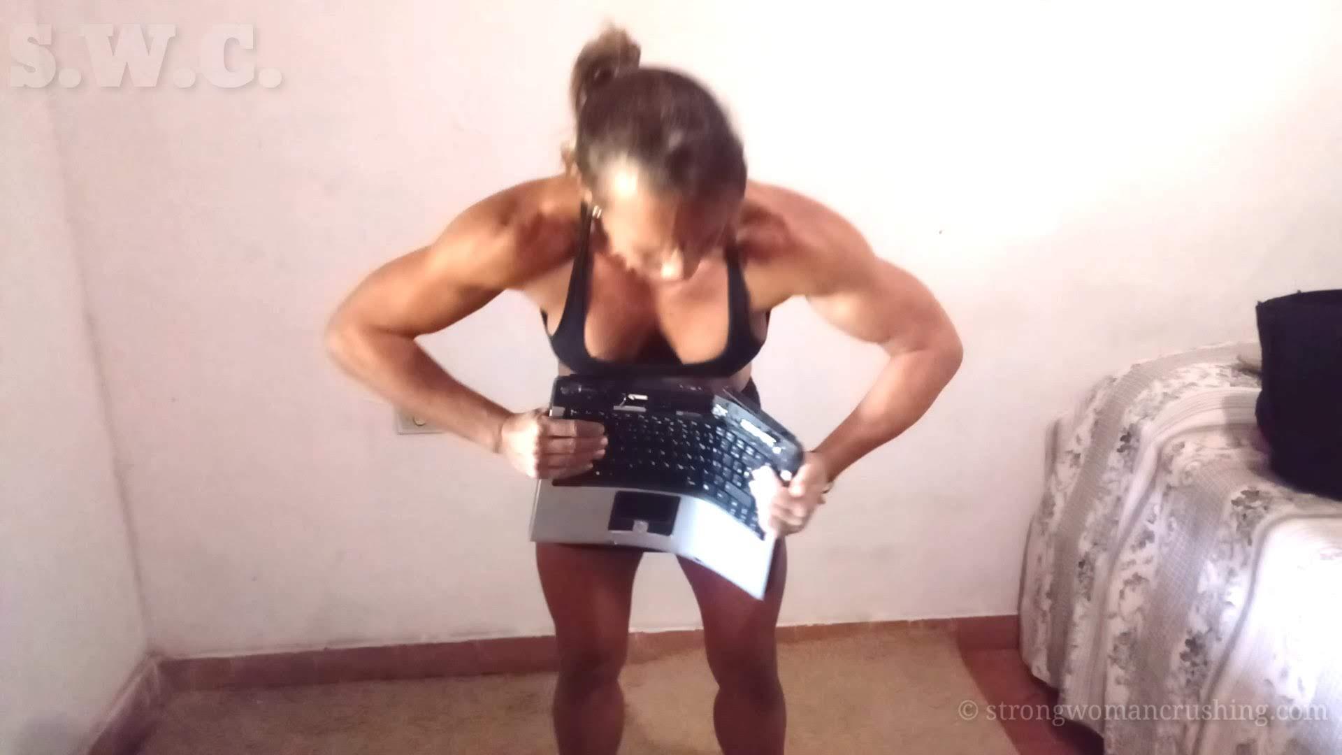 Maria Luiza tears a Notebook in a half
