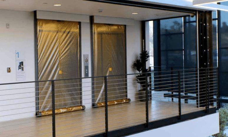 cost savings of elevator smoke curtains