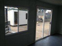 E I GROUP PORTABLES 6M X 3M SLIDING DOOR for sale