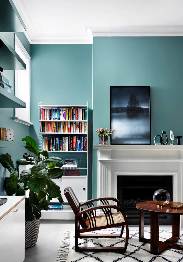 "Beautiful blues and graphic design set the scene in this [colourful Melbourne home](https://www.homestolove.com.au/edwardian-house-interior-colours-19813|target=""_blank""). The original fireplace had been removed so Lauren Li of Sisällä Interior Design, reinstated it along with ornate cornices as a nod to the Edwardian architecture."