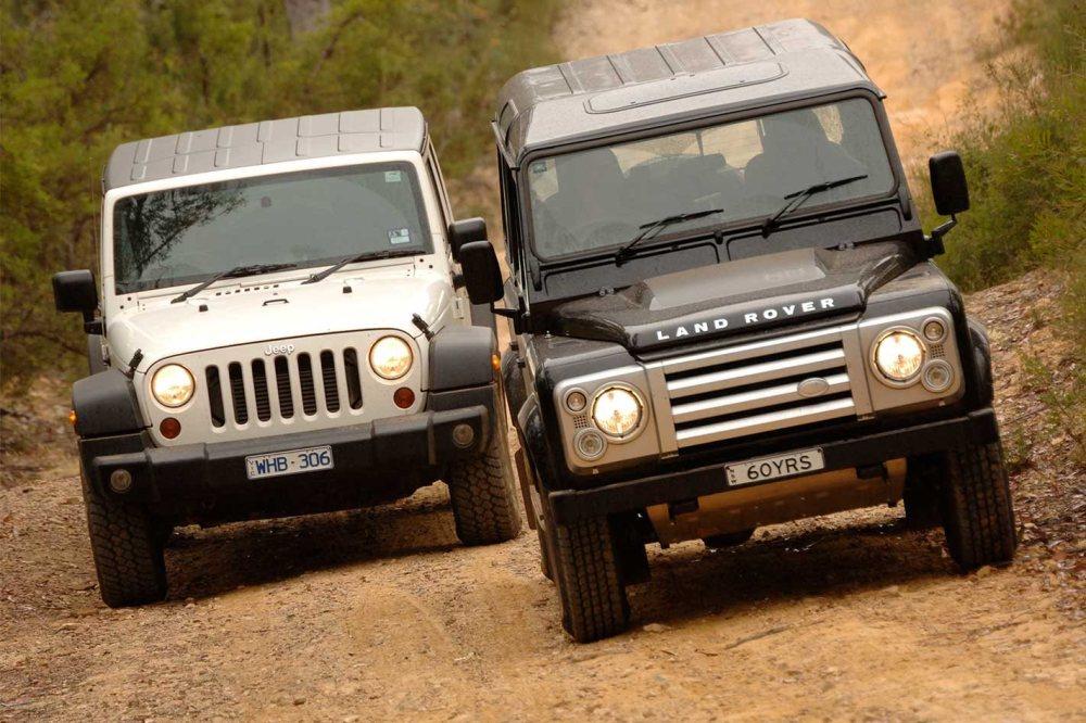 medium resolution of 2009 land rover defender svx vs jeep wrangler unlimited 4x4 comparison review
