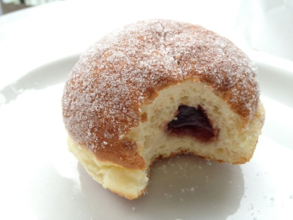 The Berliners are raised yeast doughnuts filled with black raspberry jam and coated in sugar.