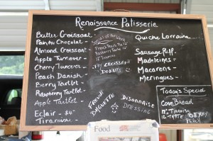 A chalkboard at the Gastonia Farmers Market lists items made by Sylvain Rivet, chef and owner of Renaissance Patisserie.