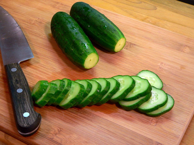 Slice each cucumber into 1/4 inch thick slices.