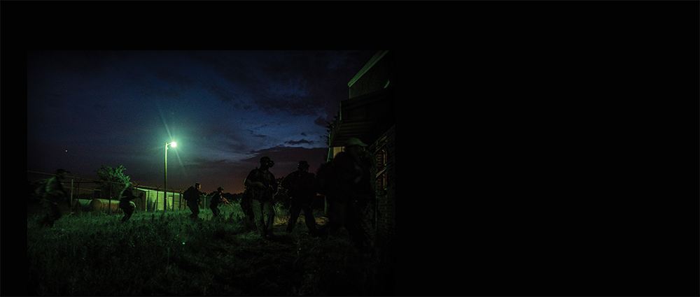 "Just after sunset, the students and guerrillas crept through an unlocked back gate and entered the prison grounds to free ""Robin Hayes"", during the Robin Sage exercise."