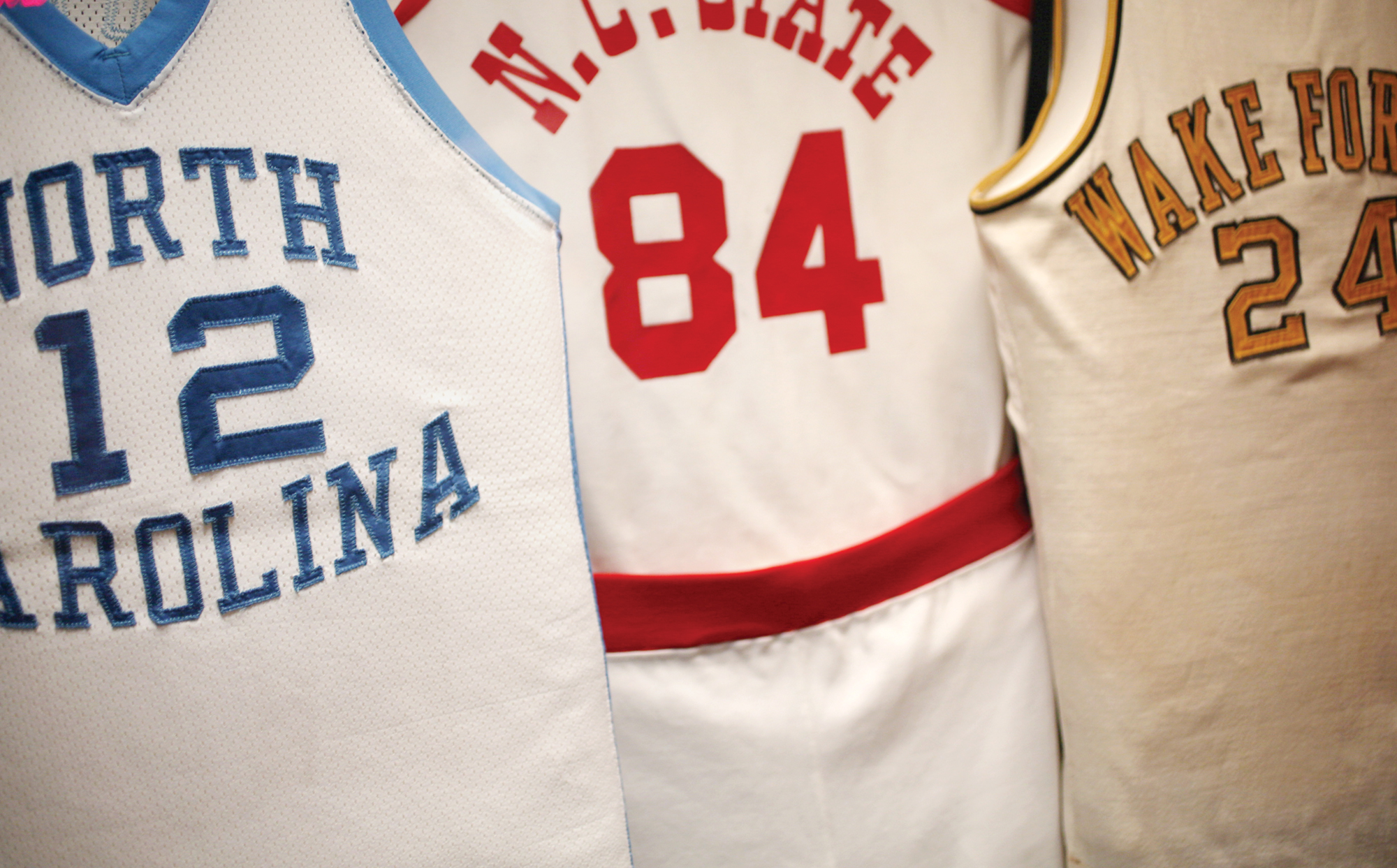 Phil Ford's #12 jersey hangs with those of other ACC greats.