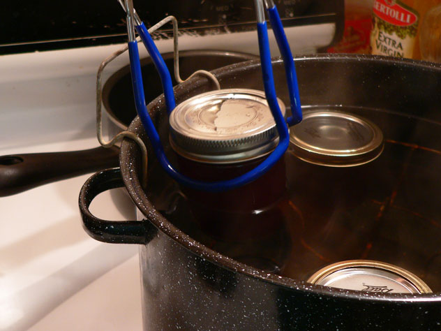 After 5 minutes, use the jar lifter and remove the jars from the rack and water. Keep the jar upright as you move it.