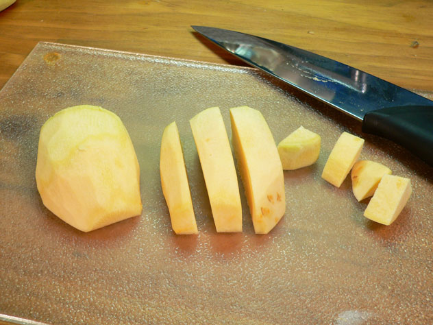By cutting the ends off, you have a flat smooth surface to help stabilize the vegetable while you slice it. I stand mine up on end, slice it in sections, then cut those sections into cubes.