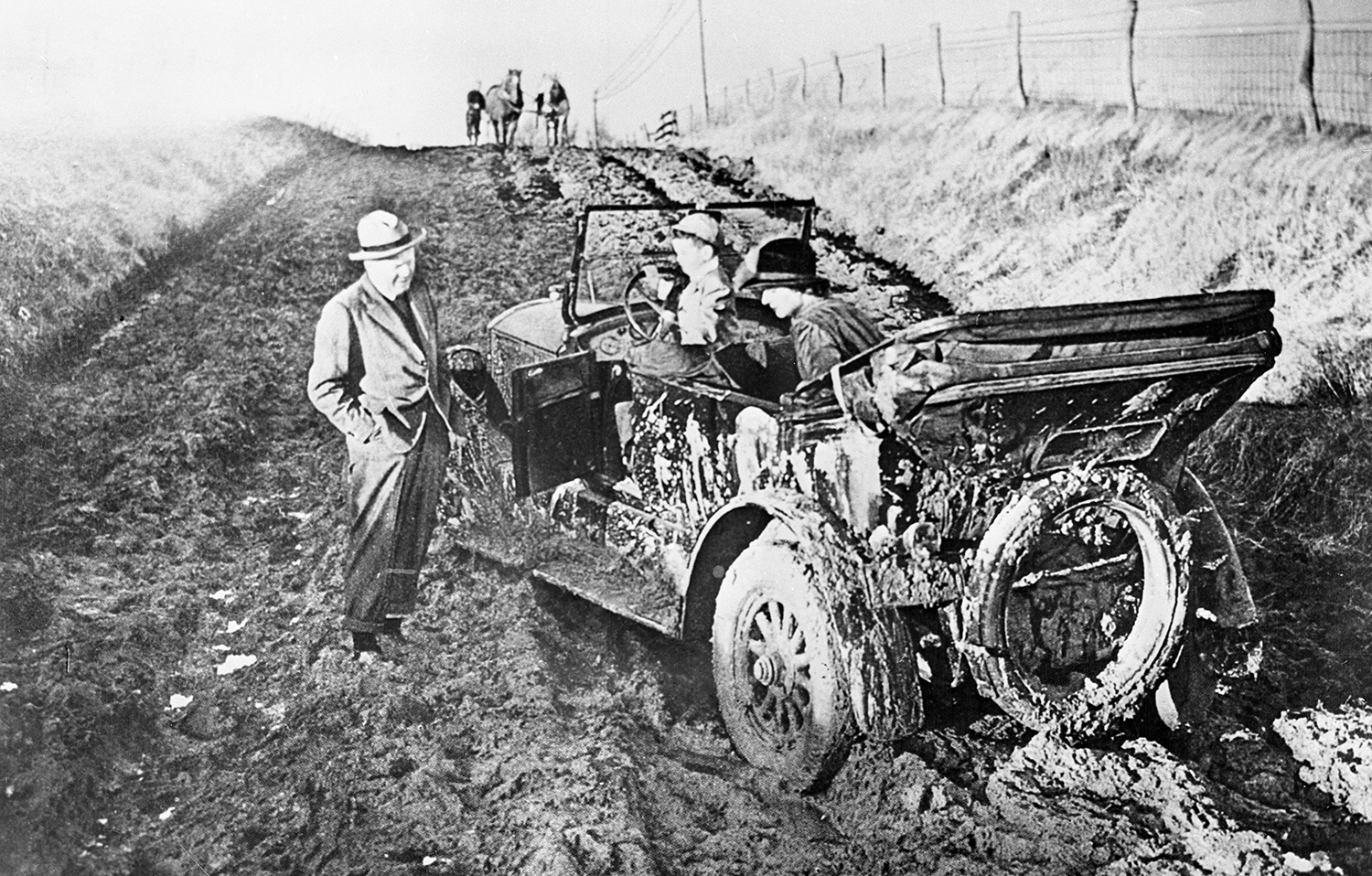 Before the Good Roads campaign, joyrides in North Carolina were more like misery rides, especially if you got stuck in the mud, like this family did in Johnston County in 1909. • Image courtesy of the State Archives of North Carolina.