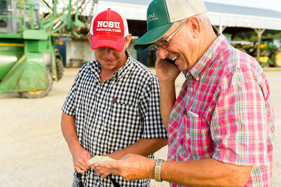Jared Penny helps his father, Andy, farm tobacco in Johnston County.