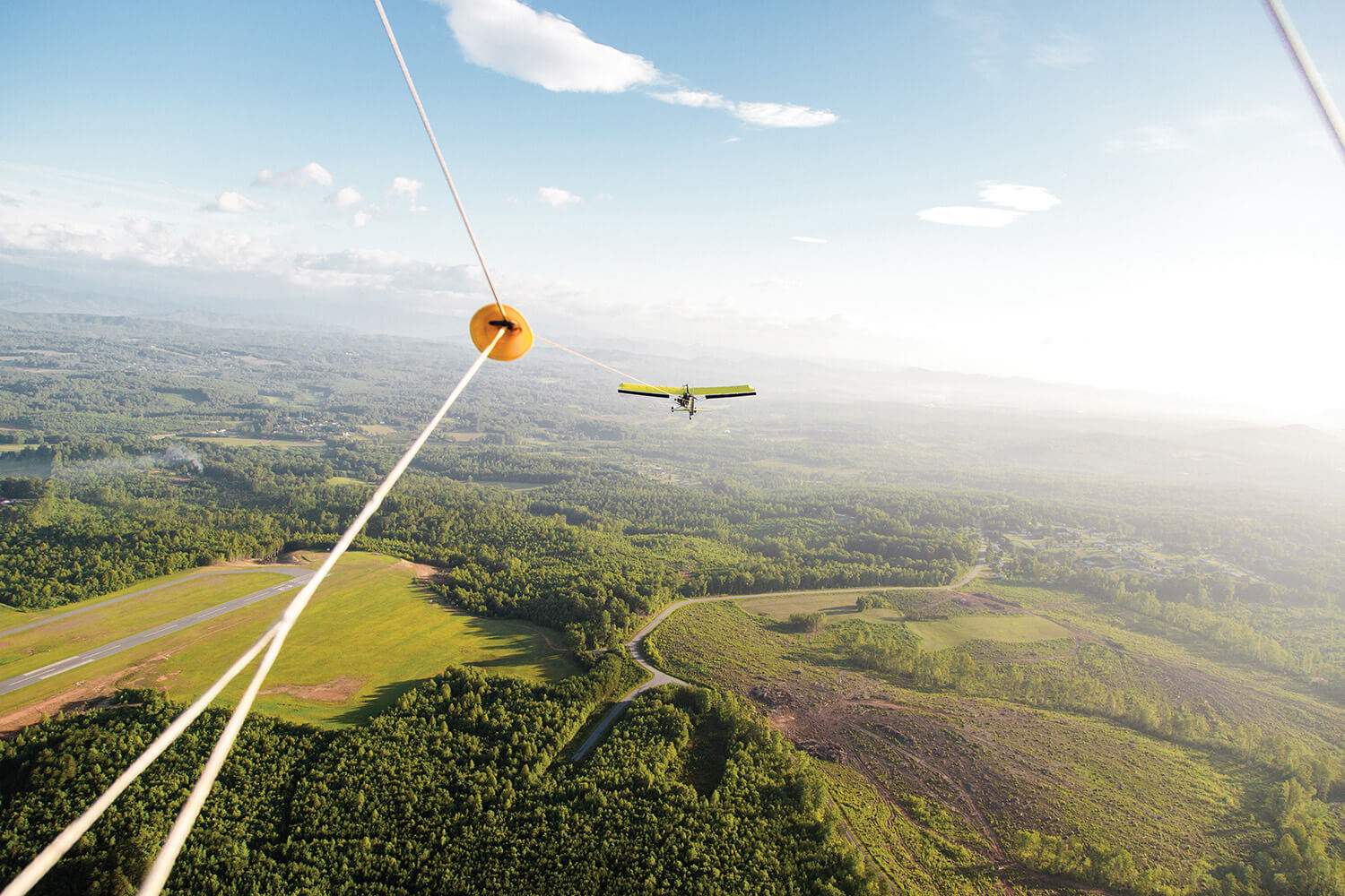 A lightplane pulls the hang glider to the proper altitude. When the line is detached, it's just the wind, and you.