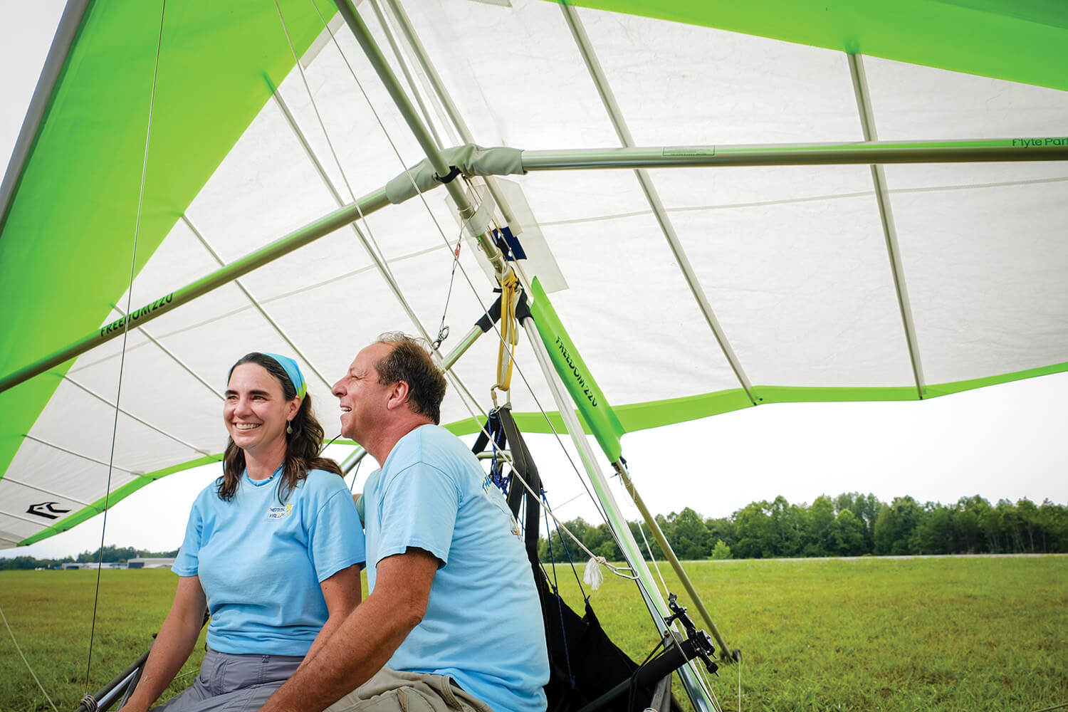 Thermal Valley owners (as well as husband and wife) Craig and Laura Pearson catch a breath beneath a glider's wings.