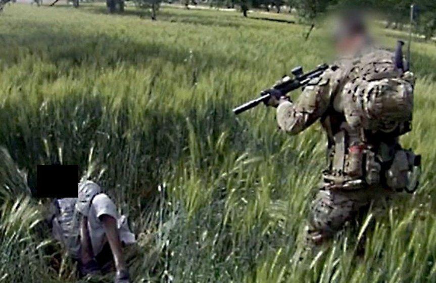 SAS execute a civilian in a grassy field