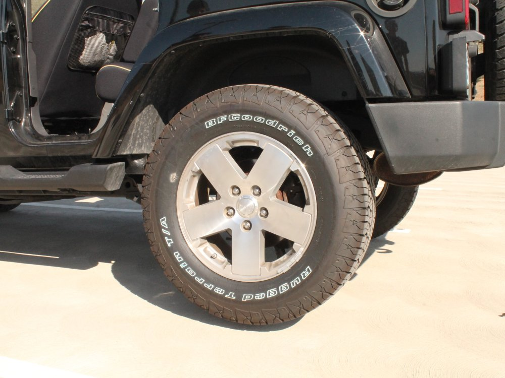 medium resolution of changing a tire on the 2007 2012 jeep wrangler