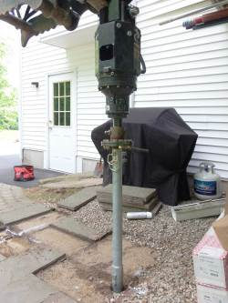 Helical screw pile post installed under a porch.