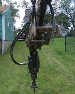 Bobcat attachment for helical pile installation