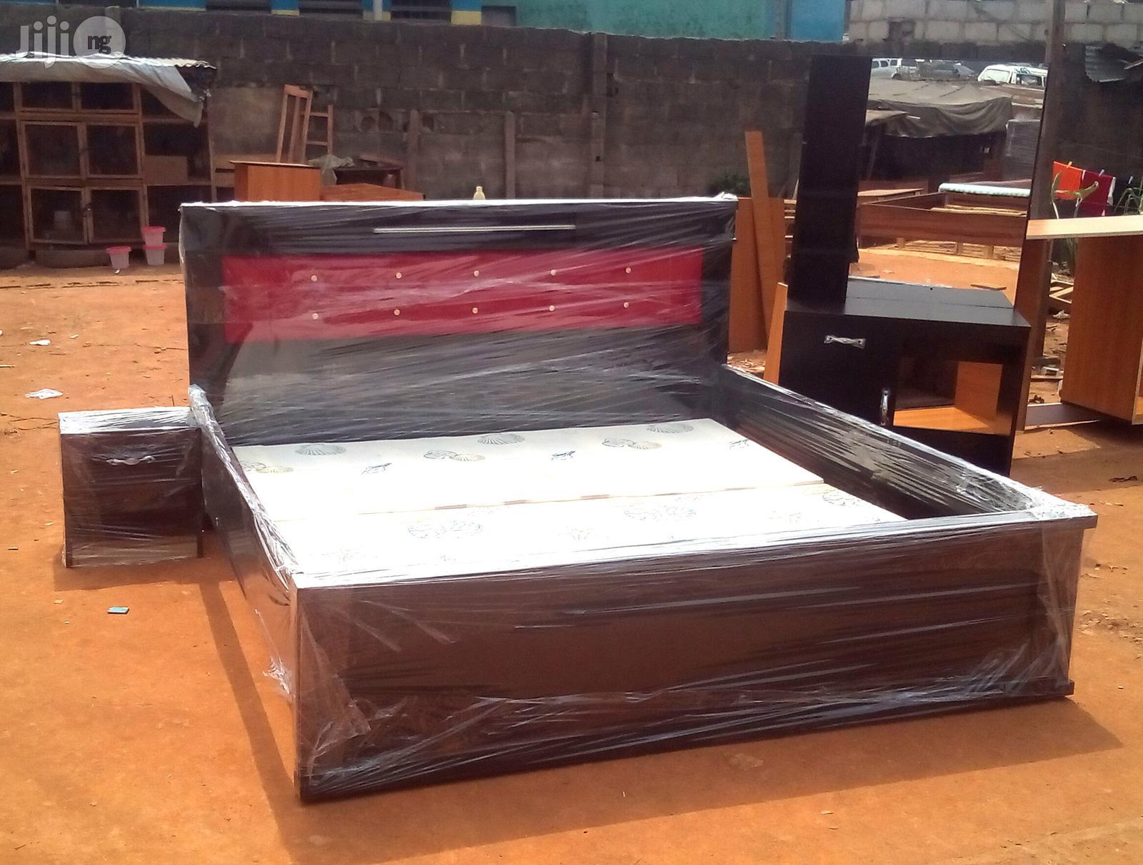 set of bed frames with dresser and bedside drawer