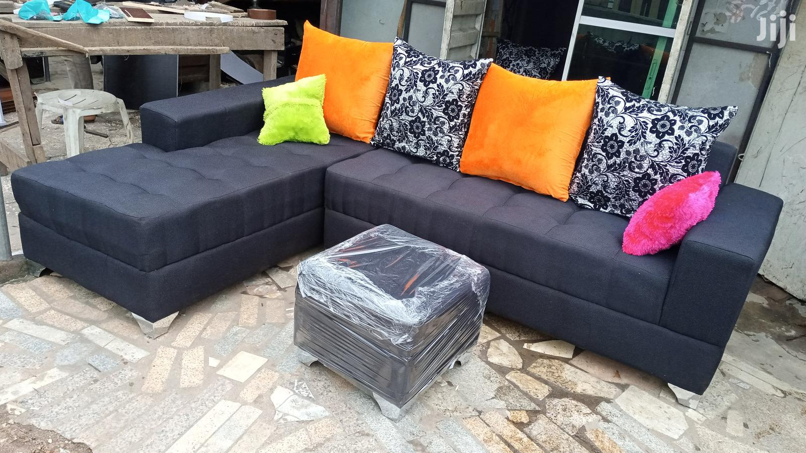 l shaped sofa chairs and ottoman puffy table black fabric couches