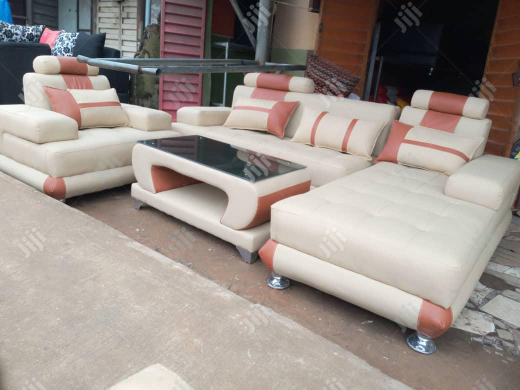 l shape leather sofa with center table