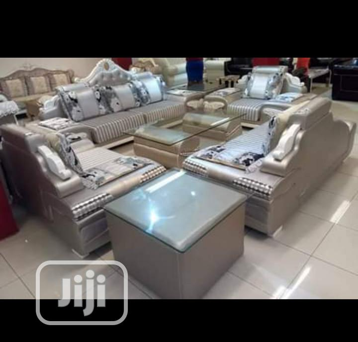 original sitting room sofas with glass center table and side stoll