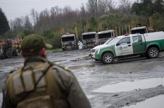 Escena del lugar donde fueron quemados 29 camiones. (EFE).