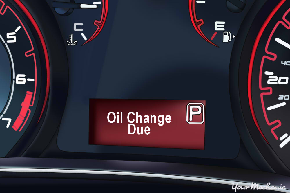 Understanding Dodge Service Indicator Lights - Dodge instrument display with the oil change light on