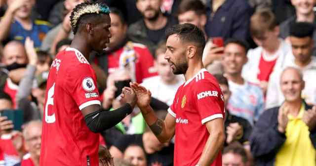 Bruno Fernandes (right) celebrates scoring their side's first goal of the game with team-mate Paul Pogba during the Premier League match v Leeds at Old Trafford