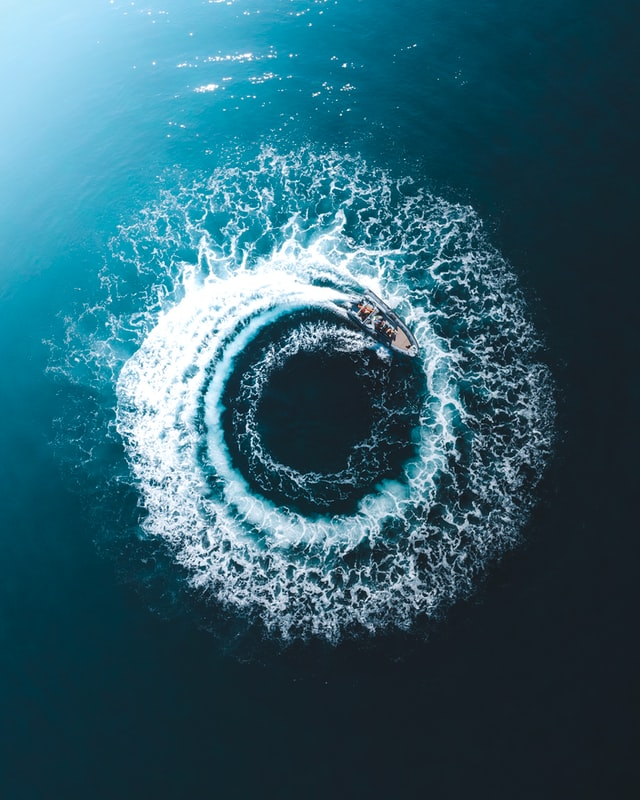 Speedboat making a tight circle in blue water