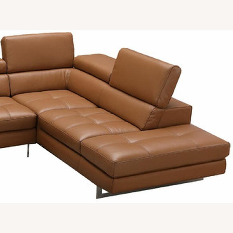 sectional in caramel leather w adjustable armrest