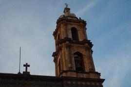 A church spire off a plaza at SLP